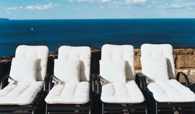 Sun loungers with an ocean backdrop.