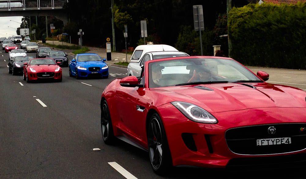A Jaguar F Type convertible convoy.