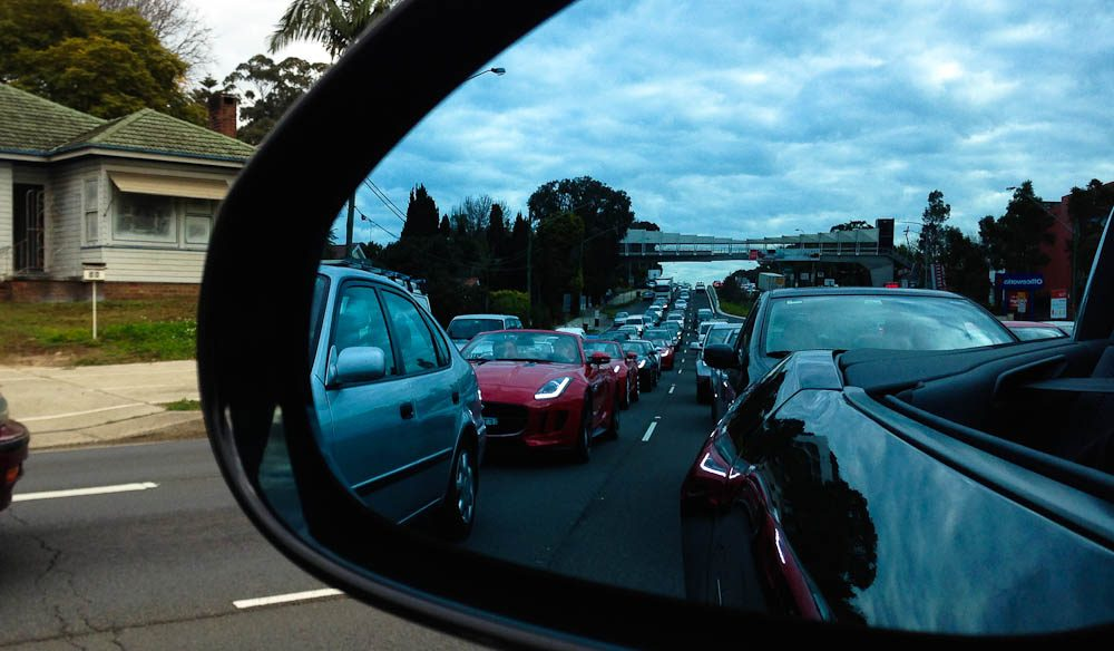 A Jaguar F Type convertible convoy in crawling Sydney traffic.