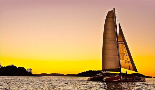 Sailing into the Whitsundays sunset, drink and canape in hand, of course.