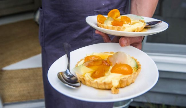 Goats milk custard tarts with vanilla-poached cumquats and candied citron