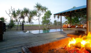 Firepit and infinity pool Bamurru Plains Lodge