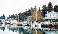 Boats hug Port Fairy's pretty wharf