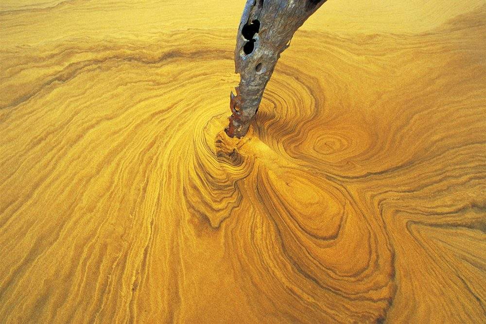 The sand mining controversy of the early '70s that led to Fraser's eventual eco-preservation was centred around key minerals such as rutile, a natural form of titanium oxide and also the cause of the dark swirls wurrounding tap root on the Stonetool Sandblow.