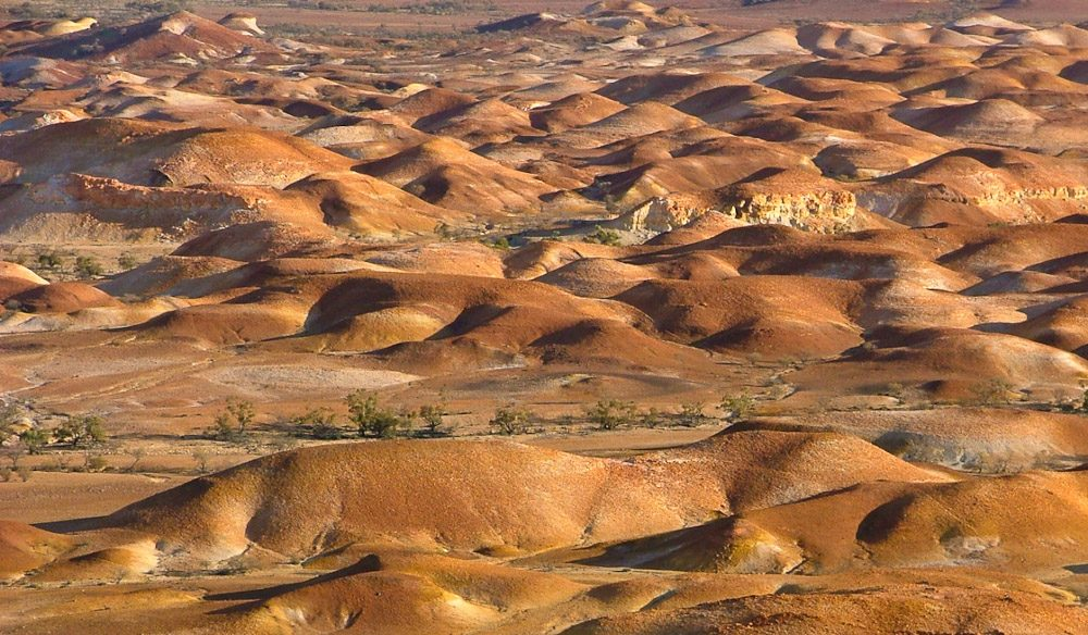 The heaps formed by mining for opals pock the landscape at Coober Pedy. Outback South Australia