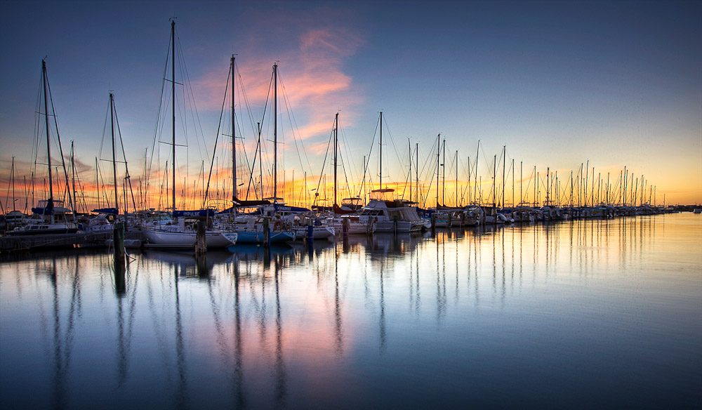 The long lines of bobbing boats as dusk settles over the Fremantle Yacht Club.. Image by Jonathan Pang www.jonathanpang.com.au.