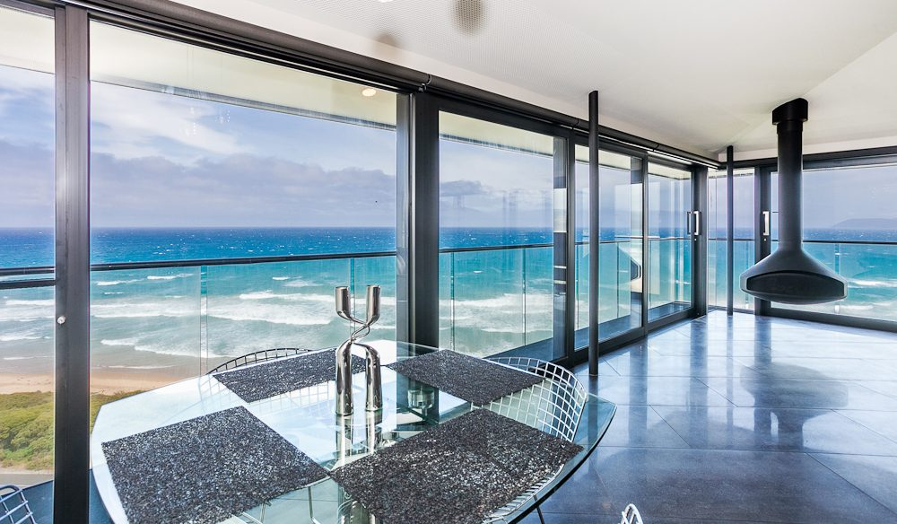 Floor-to-ceiling retractable glass walls, The Pole House, Fairhaven.
