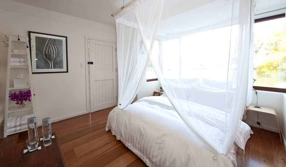 The wooden floored bedroom with Egyptian cotton sheets.