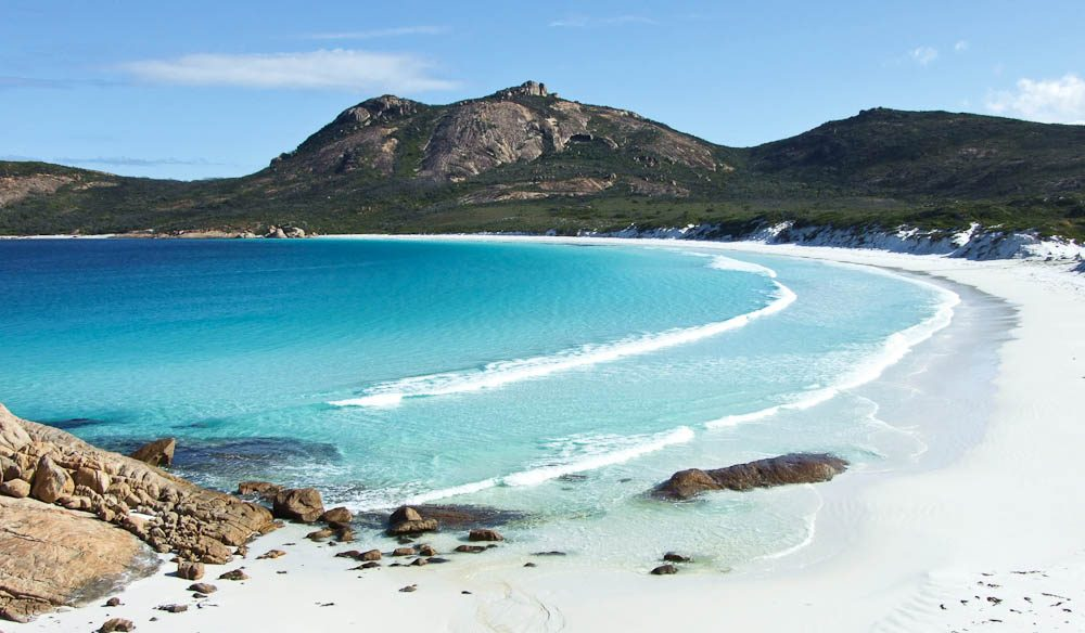 """Hellfire Bay has the most beautiful aquamarine water edged with white, fine squeaky sand"