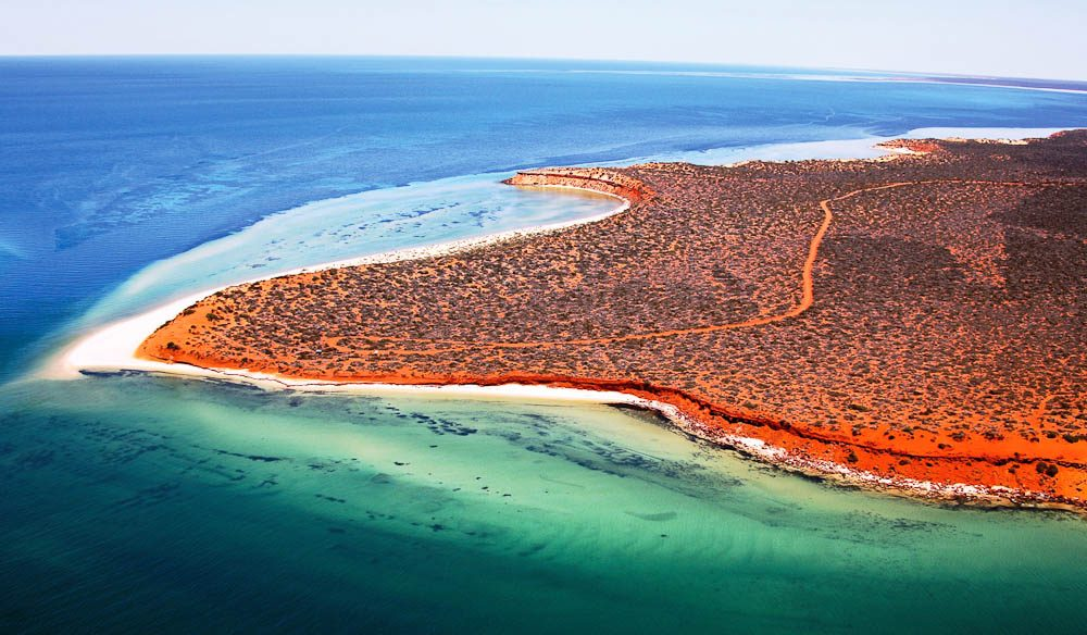 """Shark Bay is renowned for its bright white beaches, turquoise waters, rust-red sands and plethora of marine life"