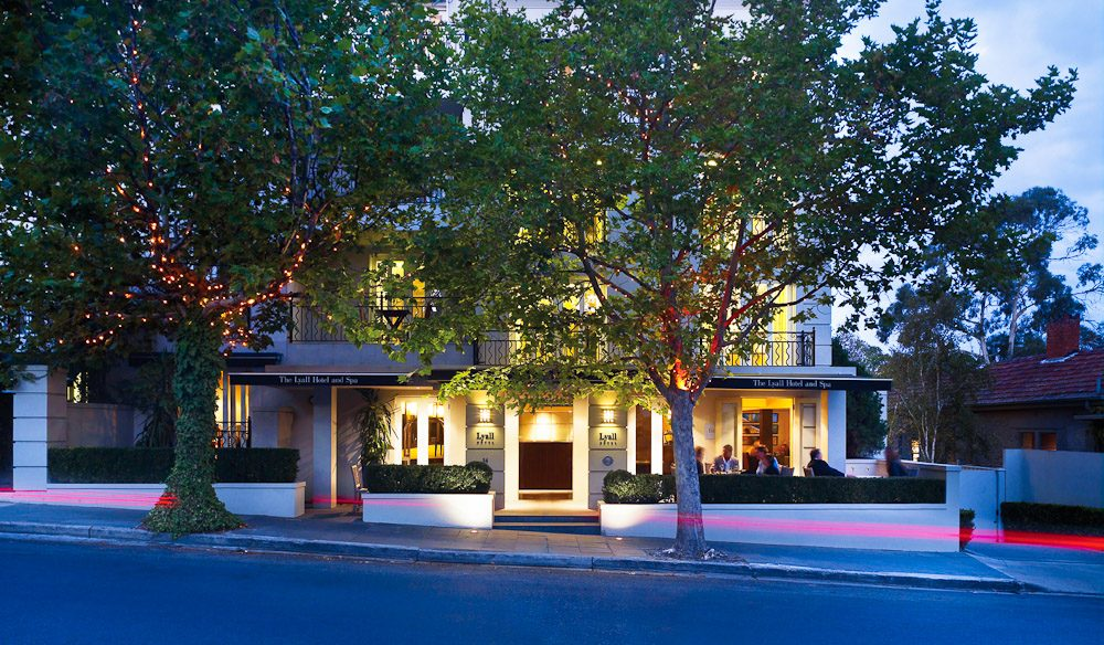 Exterior of The Lyall Hotel at dusk.
