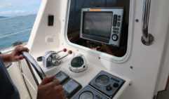 Taking the helm of Sirocco (photo: Celeste Mitchell).