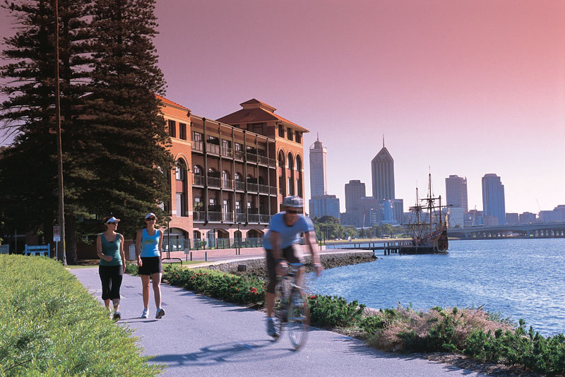 Countless cycling and walking paths ring the city, like this one which passes by the old Swan Brewery. Image by Tourism WA