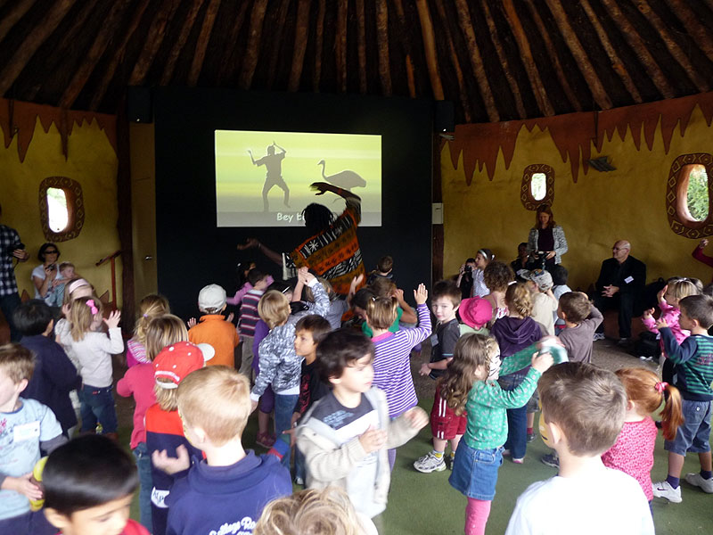 """Werribee Open Range Zoo says that kids are encouraged to play bongos, wiggle hips, stamp feet and """"call animals to water""""."""