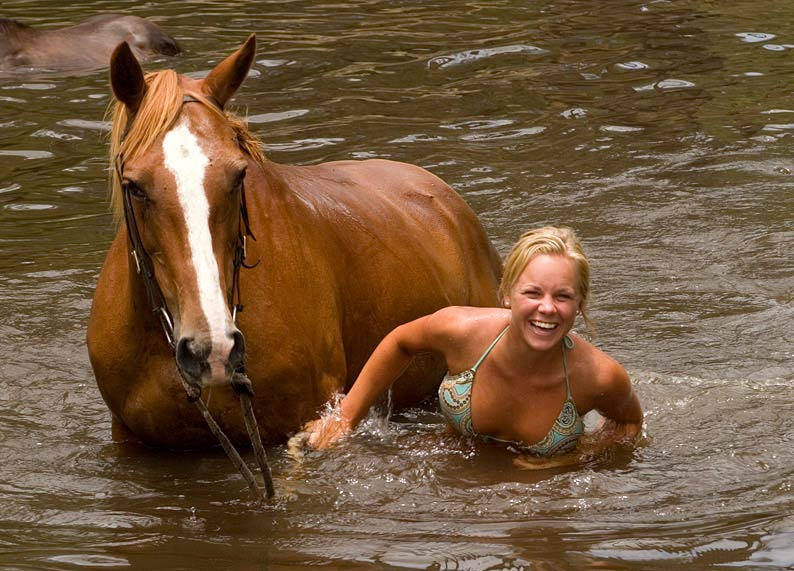 A touch of well-earned aqua therapy for horse and Jillaroo alike.