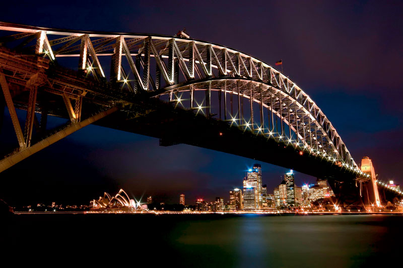 The Bridge sparkles against the backdrop of the Sydney skyline. Image by George Suresh