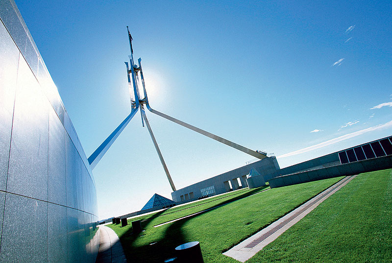 The flag flies over Parliament House, Canberra. Image by Australian Capital Tourism