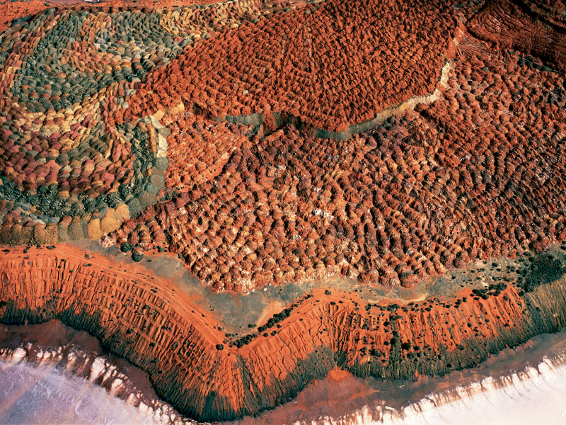Dam with plough patterns near Narrabri, NSW. The plough creates patterns as it deviates around rocks and vegetation and, combined with the colours in the soil, forms a subtle pattern. Image by Richard Woldendorp
