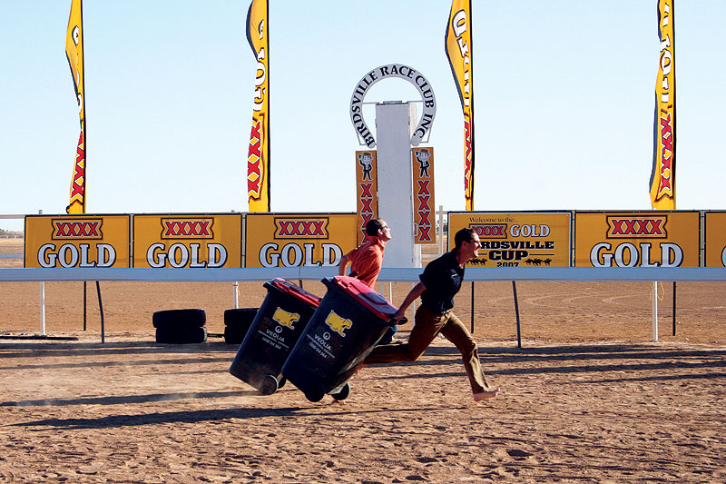 A barefoot Rocky lunges over the line with his trusty wheelie bin in tow.