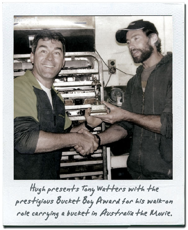 Hugh presents Tony Watters with the prestigious Bucket Boy Award for his walk-on role carrying a bucket in Australia the Movie.