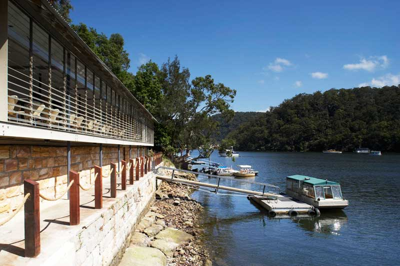 Nestled on the banks of the Hawkesbury River, the Glenn Murcutt-designed building is accessible by seaplane or boat but not car.