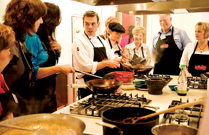 Chef Kelly Lord explains the finer points of creating black sticky rice. Image by Andy Rasheed/EyeFood