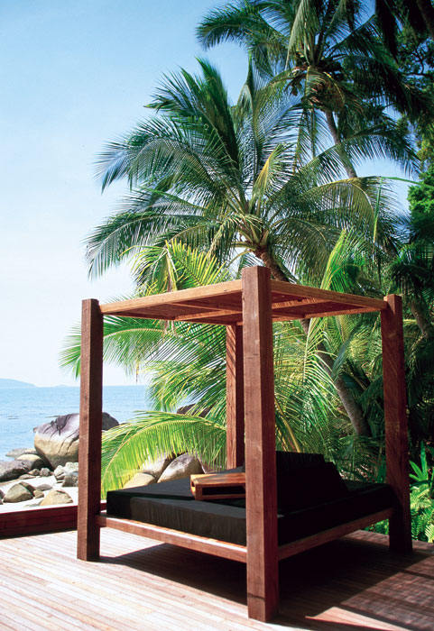 A luxurious day bed at Voyages Bedarra Island Resort. Image by Voyages Hotels and Resorts
