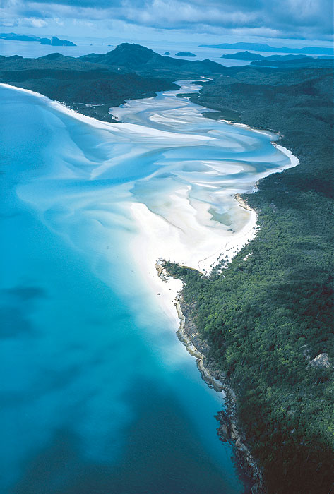 Heavily forested Whitsunday Island is home to the über-famous Whitehaven Beach. Image by Tourism Qld