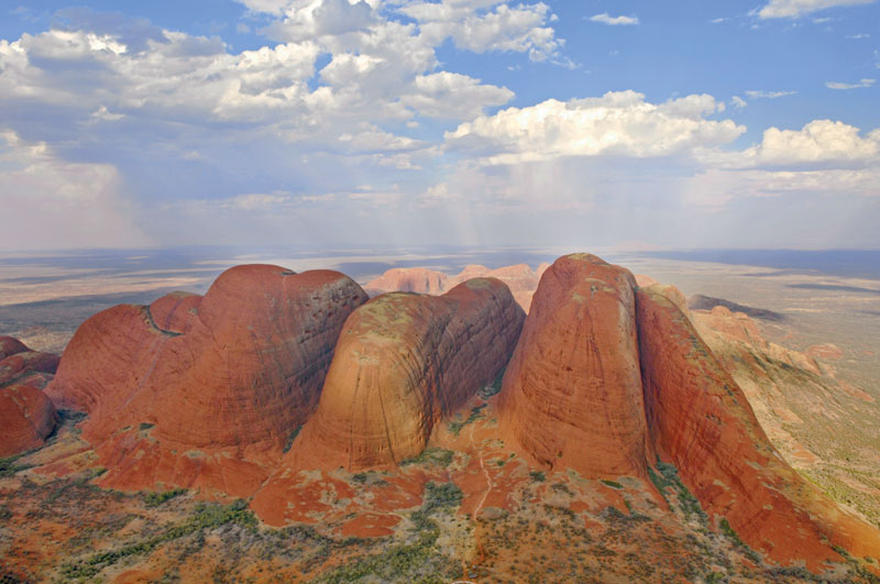 Just like a heap of Ulurus all mushed together, Kata Tjuta shines under the outback sun. Image by Tourism NT