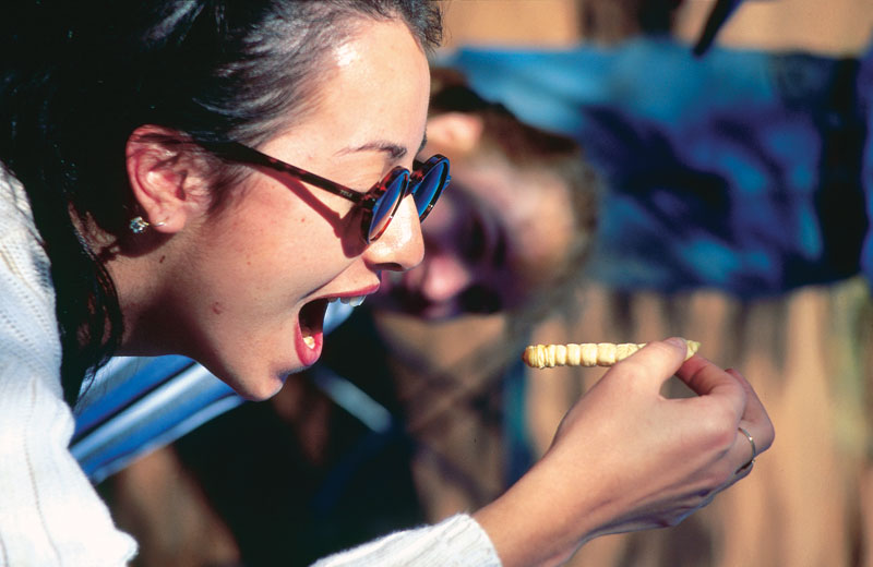 A classic witchetty grub sampling session: tastes like egg when cooked, like almond when raw. Image by Tourism NT