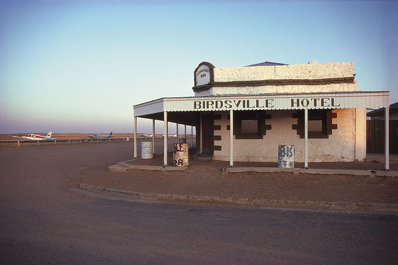Birdsville Hotel and the parking lot out the back. Image by Tourism QLD