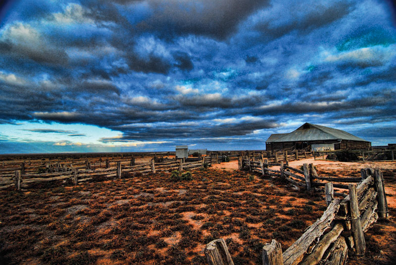 A heavily dramatic sky dwarfs the Mungo Woolshed and Sheep Yards. Image by Dirk Spennemann