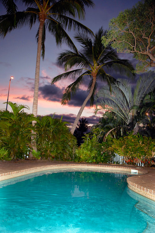 Swim in privacy beneath shady palms in your own private garden.
