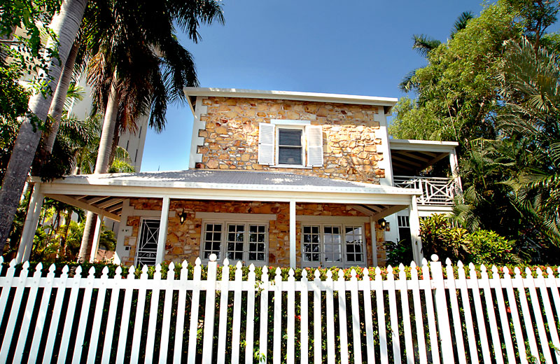 Villa La Vue surrounded by a classic white picket fence.