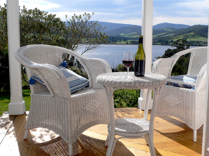 A dozen boats bob just offshore, idly viewed from the wicker chairs on your front verandah.