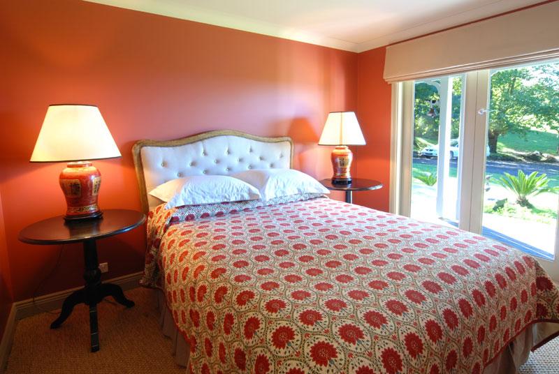 One of five elegantly furnished bedrooms.