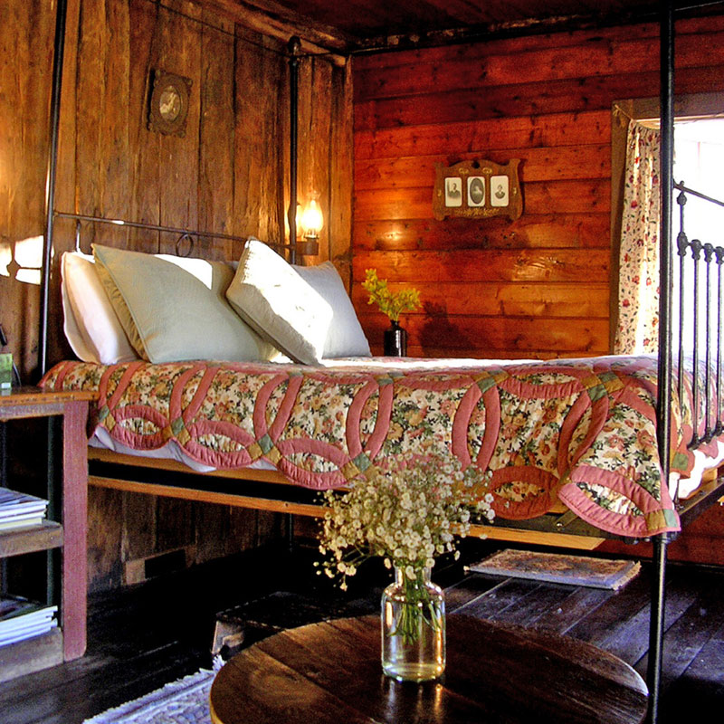A huge iron four-poster bed.