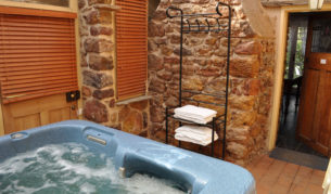 The sun-filled atrium and four-person spa bath lure guests back year after year.
