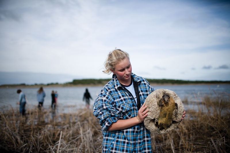Fifteen-year-old Rebecca Jackson holds the shell of a long-deceased turtle found on the banks of the Lower Murray River. Photograph by Randy Larcombe.
