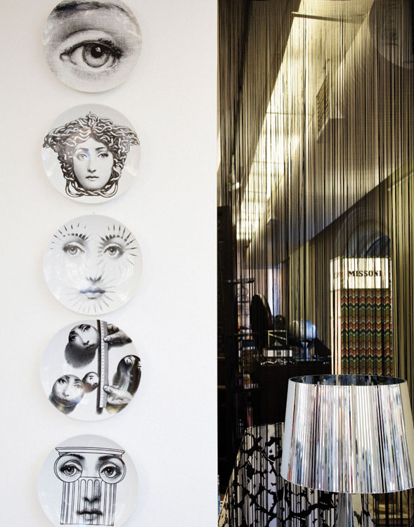 The welcoming array of Fornasetti plates on show at Macleay on Manning in Potts Point, Sydney