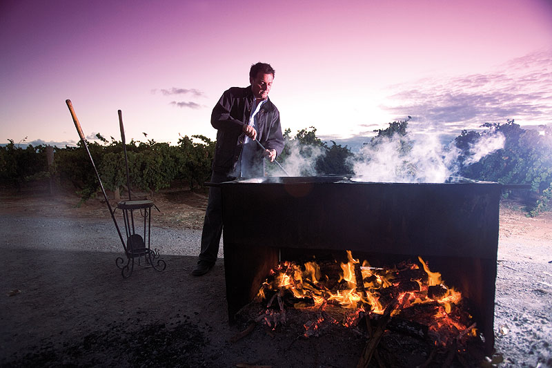 Joe boils white grape juice over a wood fire for his aged vinegar.