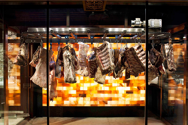 Aging meat rotates slowly around a glass cool room and shelved poultry sits proudly like Manolos on a socialite's shoe rack.