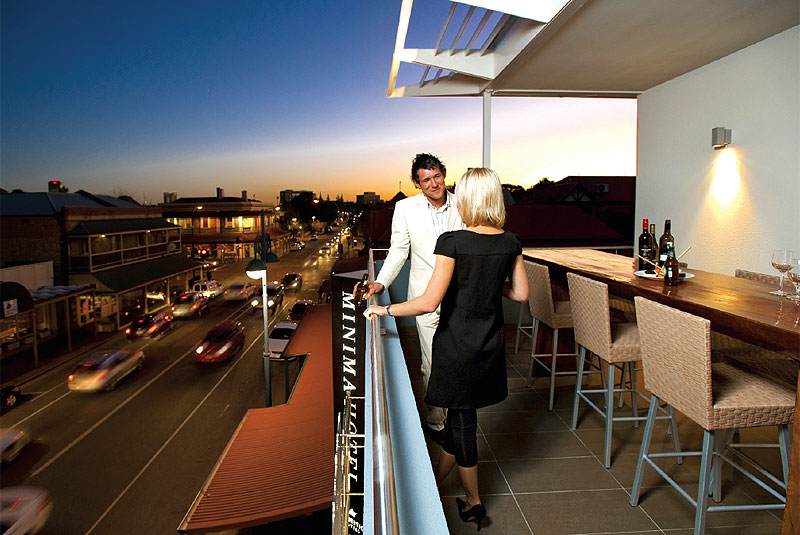 The rooftop terrace overlooking busy Melbourne St, with the superb Lion Hotel nearby.