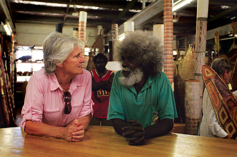 An art tour guest chats with John Mawurndjul in Maningrida.