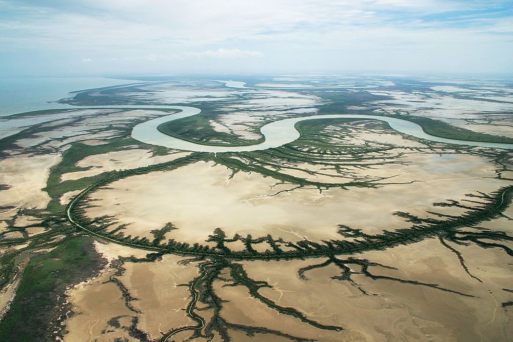 At the mouth of the Norman River Karumba is surrounded by wetlands. Image by Tourism Qld