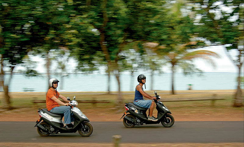 Scooting around town, the best way to travel. Image by Tourism NT