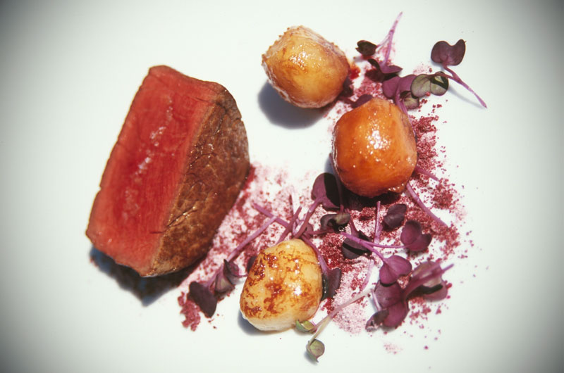 Beef with dehydrated vegetables and beetroot sand.