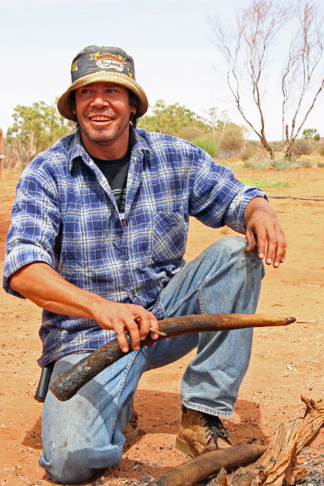 NT Oilve oil tycoon Craig Le Rossignol with a freshly coal-cooked outback delicacy: seared kangaroo tail. Definitely an acquired taste . . .