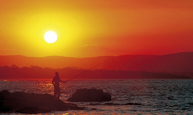 A spot of tranquil sunset fishing at 1770. Image by Tourism Qld