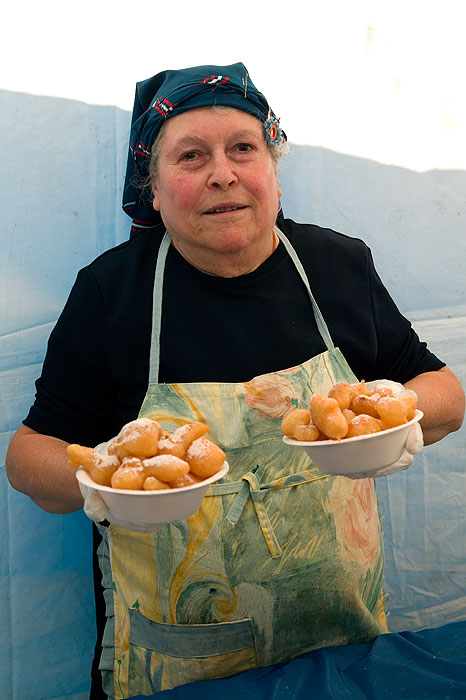 A chef prepares the goods at the honey puff-eating competition at the Paniyiri Greek Festival.